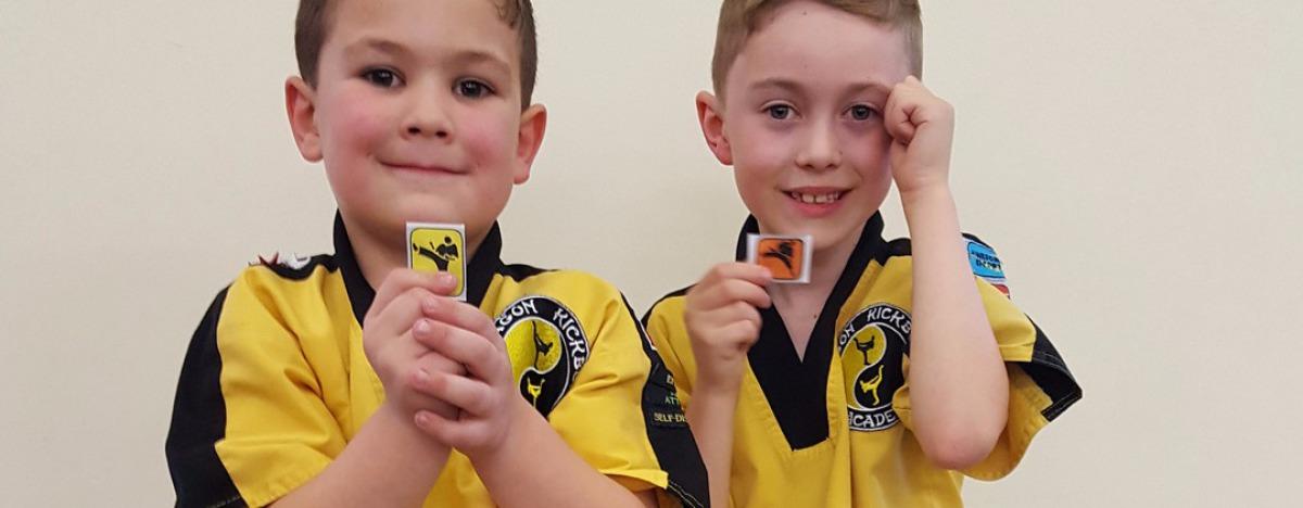 Kids receiving merit badges
